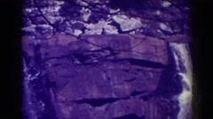 1938: a waterfall pours down steep cliffs into the river BLACKWATER FALLS WEST Stock Footage