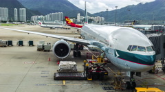 Aircraft Cathay Pacific is preparing to load luggage in Hong Kong Airport Stock Footage