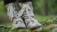 Girl jumping and danceing  through the leaves Stock Footage