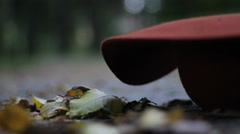 Maroon hat is falling down and girl is picking up it Stock Footage