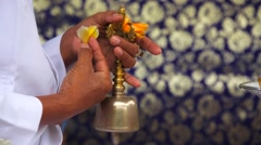 Priest ringing a bell and performs the ritual of Veneration of the dead. Stock Footage