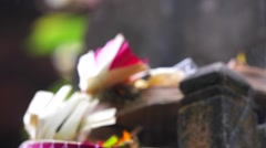 Smoldering incense on statue. Closeup. Veneration of the dead. Bali indonesia Stock Footage