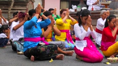 Balinese family praying at the ceremony of Veneration of the dead. Stock Footage
