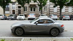 Luxury BMW M2 Coupe parked in old city Stock Footage