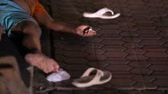 Beggars on the streets of Ubud. A poor child closeup. Night Ubud. Stock Footage