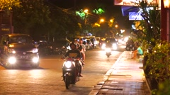 Street of Ubud at the evening. Local cafe facade view. Tourists in cafe. Road Stock Footage
