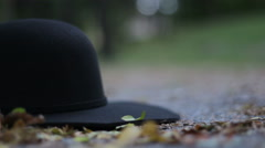 Black modern hat falling down Stock Footage