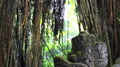Famous dragon bridge in Sacred Monkey Forest near Ubud. Ancient stone statues. Stock Footage