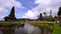 Water temple Pura Ulun Danu on a lake Beratan. Flower bed on the shore. Stock Footage