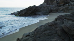 Beautiful Beach Rocks Waves Crashing Sunrise 5K HD Stock Video Footage Stock Footage