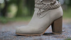 Womans legs in high heels beige boots walking away Arkistovideo