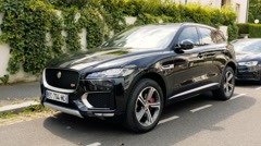 Jaguar F-Pace crossover parked in front of luxury house Stock Footage