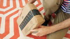 Happy customer opening Amazon Prime membership cardboard Stock Footage