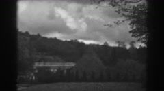 1938: storm rolls in over manicured park setting. WINCHESTER MARYLAND Stock Footage