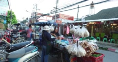 4k - Thai vendor sells fruits on Loi Kroh Road Stock Footage