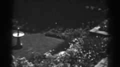 1938: top view of a garden with a fountain like pillar in between WINCHESTER Stock Footage