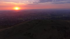 Aerial view flying down towards the Malvern Hills at sunrise. Stock Footage