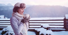 Romantic Woman Drinks Coffee, Winter Mountain Background. 4K SLOW MOTION 120fps Stock Footage
