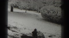 1938: little kid out playing in the snow. MARTINSBURG WEST VIRGINIA Stock Footage