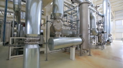 Grain processing plant Large storage space and metal pipes. Stock Footage