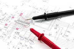 Electricity diagram (drawing or design) and pointed electrical test probes Stock Photos