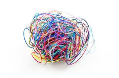 A ball of colourful cables isolated on white background Stock Photos
