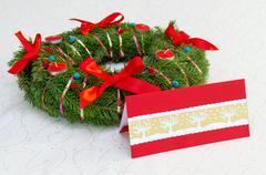 Classical Christmas wreath with red candles and card on the tablecloth Stock Photos