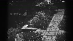 1938: unique landmark tiles and pedestal grasses all around  Stock Footage