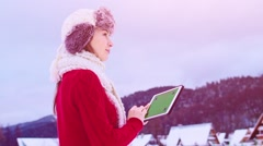 Woman Using Tablet Chromakey Screen in Winter Outdoors. STABILIZED SLOW-MO Stock Footage