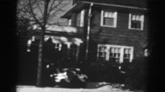 1938: beautiful view of a big house with trees on front in winter WINCHESTER Stock Footage