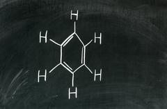 Molecule structure of Benzene, aromatic hydrocarbon written on blackboard Stock Photos