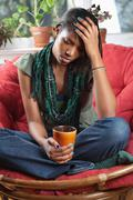 Distraught woman sitting on chair Stock Photos