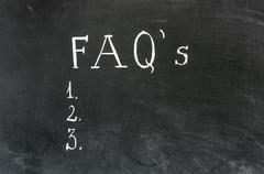 FAQ frequently asked questions written on blackboard Stock Photos