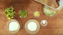 Yogurt soup in colors garlic and cucumber dill Stock Footage