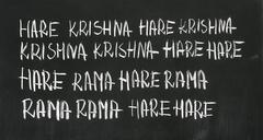 "The Hare Krishna mantra (Maha Mantra, ""Great Mantra"") on the blackboard. Stock Photos"
