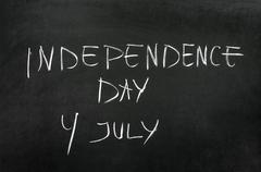 Word's Independence Day writed on blackboard with chalk Stock Photos