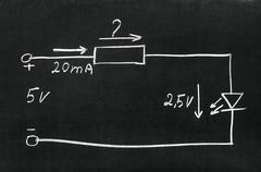 On blackboard painted with chalk electrical scheme. Calculate the resistor. Stock Photos