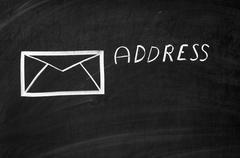 On the blackboard drawn envelope and writen address Stock Photos