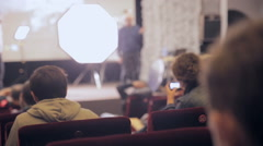 Presentation, conference, seminar. Speaker, presenter at stage making a Stock Footage
