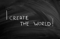 I create the world written on the blackboard with chalk Stock Photos