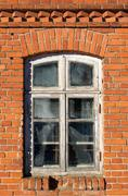 Window at front of an old brick house Stock Photos