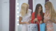 Three girls looking retails after shopping in shop Stock Footage