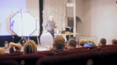 Presentation, conference, seminar. Speaker, presenter at stage making a Stock Footage