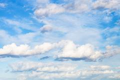 White clouds in blue sky in september day Stock Photos