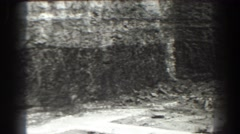 1938: constriction site near to a ride of earth with materials scattered Stock Footage