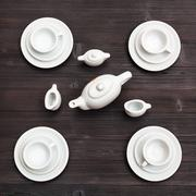 Above view of tea set on dark brown board Stock Photos
