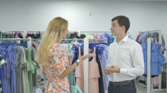 Girl ask her boyfriend give credit card in shop Stock Footage