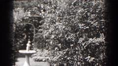 1938: a quiet garden with a stone birdbath at daytime CUMBERLAND MARYLAND Stock Footage