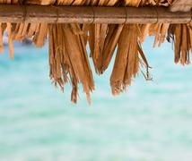 Closeup of straw sunshades ,with space for your message ,summer travel vacati Stock Photos