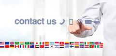 Hand touch screen display with global contact us concept text, flags and icon Stock Illustration